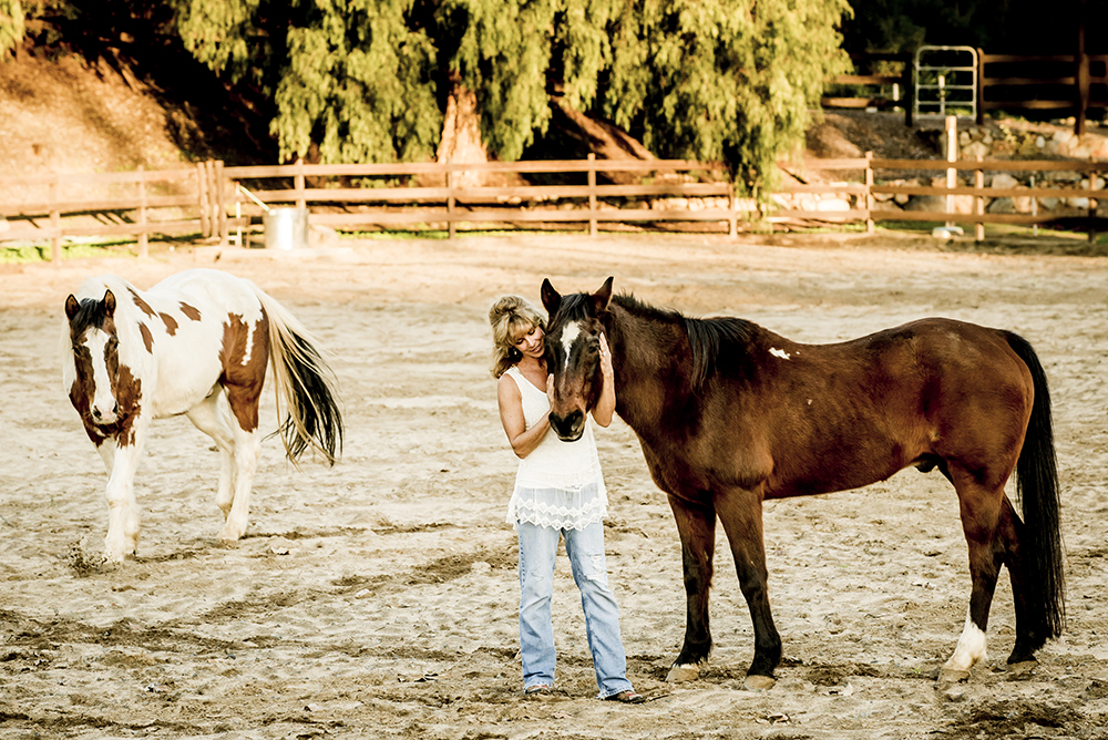 annie-with-her-horses-at-painted-sky-ranch